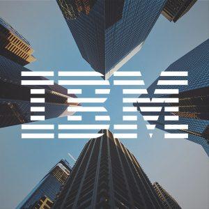 Logo IBM devant 4 grattes ciels